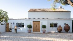 CORE architects use rustic materials to refurbish beach house in portugal Dressing Room Design, Open Space Living, Balcony Design, Entrance Doors, Spanish Style, My House, New Homes, House Design, Design Hotel