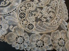 Point d'Angleterre. more properly duchesse with point de gaze needle lace insets. sometimes called Brussels duchesse.