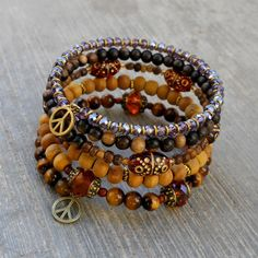 Boho chic - Amazonite, Tigers eye, howlite, African trade beads, Turquoise, Onyx, and wood beaded bangle yoga jewelry. $98.00, via Etsy.