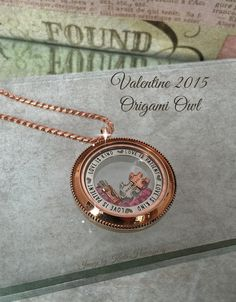 Valentine 2015 Origami Owl. The new Window Frame - Love is Patient, Love is Kind.  Paired with a Rose Gold Heirloom Locket.  New PINK stardust crystals, puzzle pieces that separate, and rose gold bucket of arrows!