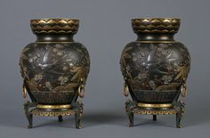 A Pair of 'Japoniste ' Bronze Vases parcel-gilt and multi-patinated - Designed by Emile-Auguste Reiber for Christofle & Cie., circa 1880 - Each inscribed Christofle & Cie and 561 - Exhibited The Great Centennial Exhibition, Philadelphia, 1876 International Fair, Paris, 1878 - H: 8 ¾ in (22 cm)