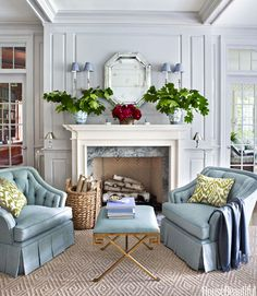 In the living room of a Greenwich, Connecticut, house, designer Ashley Whittaker created a cozy spot for two with a pair of the homeowners' favorite chairs and a Currey & Company Circe bench. See more designer living rooms - HouseBeautiful.com