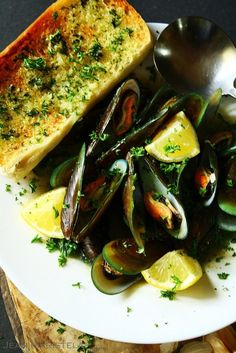 Poached Mussels in Ginger, Shallots, Garlic and White Wine Broth
