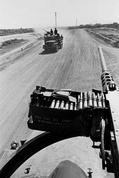 The .50 caliber machine gun mounted on a truck in a USMC convoy.