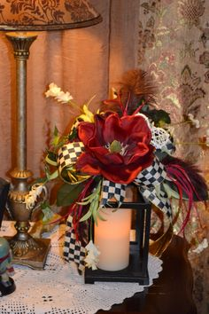 MacKenzie Childs ribbon lantern swag. Burgundy magnolia, feather plumes, wild flowers. Lantern not included, always use a battery candle, no live fire.