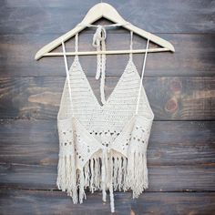 Unlined halter crochet top with fringe. Tie neck and tie back. Imported.