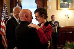 Captain Mark Kelly hugs his wife, Congresswoman Gabrielle Giffords, after receiving the Legion of Merit from Vice President Joe Biden during a retirement ceremony in the Secretary of War Suite in the Eisenhower Executive Office Building, in Washington, D.C., Oct. 6, 2011. (Official White House Photo by David Lienemann)