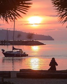 Spring Sunset A Solo Lover Sits On Log At Beach Park What Better Place To Be See It All Go Down Sailboat Passes By And Heads