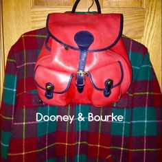 "♦️Dooney&Bourke♦️ Leather Backpack Red/Black Trim ♦️Genuine Dooney & Bourke♦️gorgeous unique color combo, discontinued ""glove leather"" collection. Inside 1-nylon pocket/snap, zipper & slip pocket, outside 2/front snap pockets/back slip pocket. The top/drawstring/fold-over buckle flap for safety! The only wear is shelf life, like new condition, a little black edging on the straps are gone. Back straps adjustable/removable & can be carried by top hand loop. Trade, MC, or PP. Thanks Dooney…"