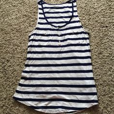 Navy Blue Striped Tank Top Great everyday top! Navy blue and white stripes. Has two small pockets on frontside and small button up around scoop neck. Small red stitching adding a cute accent! Slightly oversized for a comfortable fit. Express Tops Tank Tops