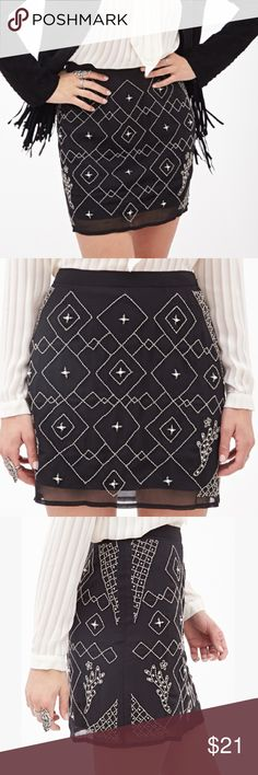 NWOT Forever 21 Women's Black Beaded Mini Skirt Never worn! This mini skirt is your next go-to for fancy dinner parties! An intricate mixed beaded design on the front with faux pearl and rhinestone accents adorn this piece. Finished with a hidden side zipper, achieving a flawless look will be a no brainer. Woven, fully lined. Lightweight. 100% polyester. Size: Medium. Forever 21 Skirts Mini