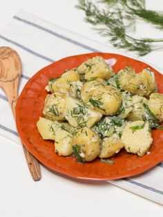Creamy Herbed Potatoes Recipe-  covered with creamy sauce and fresh herbs.