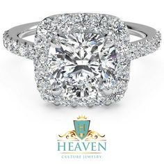 4.04 TOTAL CARAT FRENCH PAVE CUSHION HALO RING Make a lasting impression with this 4.04 Total Carat French Pave Cushion Halo 14K White Gold Ring ring from Heaven Culture Jewelry. Meticulously handcrafted, it is a fascinating Engagement or Anniversary ring for women of all ages. The band is made from solid 14K white gold. A large 3.10 Carat Moissanite cut Center adorns the top as a trellis of diamonds cascade downwards on both sides.