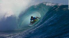 Surfer Filipe Toledo ducks under a wave at the Fiji Pro competition in Tavarua, Fiji. Gabriel Medina won the event, beati...