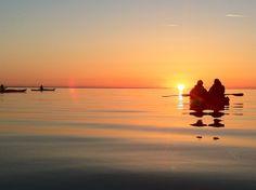 Sunrise near Mackinac Island, Michigan on kayaks. Our daily sunrise kayak tours are from 5:15 AM - 7:15 AM. Book online at http://MackinacKayak.com