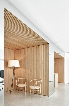 The use of the warm wood with a homely lamp gives the warmness I'm looking for, but I feel as though the overall look is too stark for where I want to take my design.