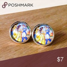 """Beauty & the Beast Stained Glass Earrings Handmade earrings with Beauty & the Beast images under glass domes.  We offer 15% off on all bundles. You can """"Add to Bundle"""" to get discount.  Most items listed are ready to ship but if you need something sooner please let us know before ordering.  Thank you for shopping my closet! Magic Main Street Jewelry Earrings"""