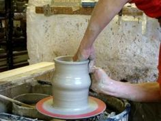 Knuckle and heel lifting techniques whilst throwing a tall clay pottery vase on the wheel