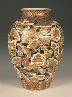An impressive Japanese Satsuma earthenware vase by Tomonobu, Meiji period, the ovoid body thickly