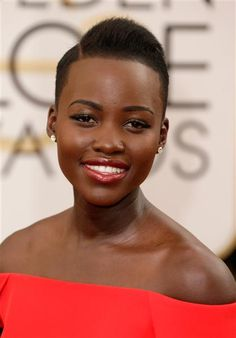 Lupita Nyong'o lets her dramatic cape and gorgeous face do the heavy lifting on the red carpet. She keeps her makeup and jewels to a minimum, choosing red lips, cat eyes and dainty yellow-gold diamond studs from Fred Leighton.