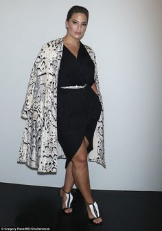 Wild about fashion! The Sports Illustrated Swimsuit cover model layered an animal print coat over her black mini dress