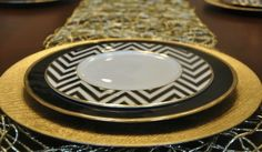 """Hi there! Did you enjoy that extra hour in your day as much as I did? Sunday felt like it was never going to end, which is a good thing:) Over the weekend, I experimentedwith a Thanksgiving tablescape in a black and gold color palette.The runner, gold charger plate and black plate with gold trim are from Z Gallerie. The chevron plate is Mikasa.I printed """"Give Thanks"""" on my computer in """"Zapfino"""" font on gold vellum paper and tied it to the pear stem with a sheer ribbon."""