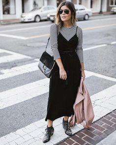 How to Make Your Go-To Dress Look Fresh: Sara Azani wears striped T-shirt underneath a slip-dress. Also wearing Chloe Ankle Boots.
