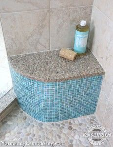 Pebble flooring for the shower works so well with transitional and modern bathroom designs!  Created by Normandy Designer Ann Stockard