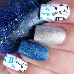 Look funky and musically-inclined with this gorgeous nail art in blue, silver and black using the stamping technique. Have fun with these nail essentials.