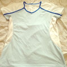 Nike powder blue and white dry fit Adorable breathable work out shirt. Some stretch to it and the fit dry everyone loves. White is see through to show of your sexy figure and cute sports bra! Nike Tops
