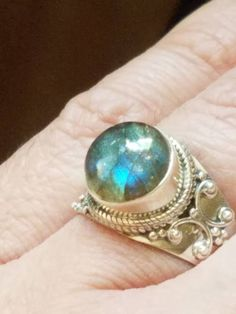 This is a handmade sterling silver ring with a very pretty flashy labradorite. This beautiful ring weighs grams and is size Feel how you'll smile when wearing this. Pretty sure you look fabulous Rock Rings, Blue Rings, Handmade Sterling Silver, Sterling Silver Jewelry, Gypsy Jewelry, Jewlery, Labradorite Jewelry, Natural Stone Jewelry, Topaz Ring