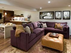 A color palette of plum, caramel, copper and cream is mixed with warm wood tones for a comfortable, homey vibe in this basement. A series of three backlit digital photos add much-needed light and give the room a personal touch.