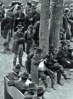 General Ulysses S. Grant (center of bench beside tree) on eve of Siege of Petersburg VA, 1864.
