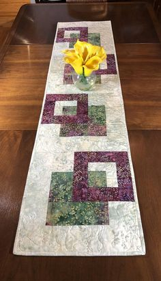 Although designed as a modern look table runner, this quilt could also be used to adorn your wall, a dresser, coffee table, sofa table, buffet, desk, bed or piano top. The wine / plum / Marsala / burgundy and green and cream color scheme is versatile and can be used in any season. A layer