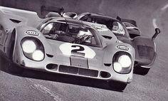 Pedro Rodríguez in the Gulf/Wyer Porsche 917K leads the Mario Andretti Ferrari 512S
