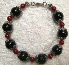 Black and Cranberry Beaded Bracelet by ACharmedLife4 on Etsy, $6.00