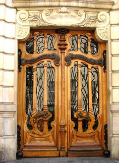 Wooden Art Nouveau Door with Glass Panes and Wrought Iron Filigree at 151 Rue de Grenelle in Paris