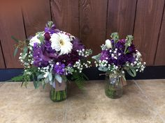 Purple and white bridal bouquet and flower girl bouquet with gerbera daisies, stock, daisies, button mums, baby's breath, tulips, seeded eucalyptus, dusty miller, and bling by #SunshineFlorist