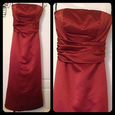 Levkoff brand bridesmaids dress A burnt orange color as well.  Heavier material with black tool underneath.  Has a satin sash around waist.  Also has alterations done and cups added into the bust to keep shape. Dresses