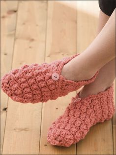 """Simple popcorns add cushiony comfort in these easy-to-stitch slippers. This e-pattern was originally published in 1-2-3 Skein Crochet. Size: Includes women's shoe size small/medium (finished foot length 8 1/2"""") and large/X-large (finished foot length 10""""). Made with medium (worsted) weight yarn and size J (6mm) hook. Skill Level: Easy"""