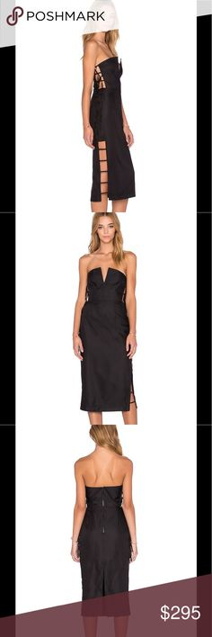 """Alice McCall Black Strapless Dress Alice McCall comes to us from London, bringing her intricate cut out dresses and girlish bohemian style. Simple and charming, a memorable keepsake for any wardrobe.  Viscose blend Dry clean only Partially lined Plastic bodice boning Side ladder cut-out with tie closure Exposed back zipper closure Neckline to hem measures approx 40"""" in length Color: Black Alice McCall Dresses Strapless"""