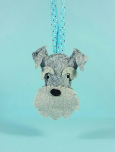 Schnauzer Felt dog Ornament - pet lover gift - Hand crafted Pet Portrait - felt animal - ornament  designed, hand cut and hand stitched by me in my smoke and pet hair free home.    These decorations make the perfect stocking stuffer, tree enhancer, teachers gift. Is your dog the ring bearer at your wedding? These would make lovely wedding favours! Convo me for volume pricing. Do you have an animal lover on your gift list? Materials: *wool felt from Benzie Design *polyester Filling. * I use a…
