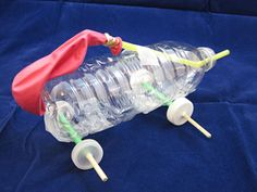 Two examples of completed balloon cars. (Left) A car with a paper body, CD wheels, and paper/pencil axles. (Right) A car with a plastic bottle body, .
