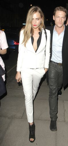 Cara Delevingne makes this white pantsuit look feminine and cool #Style