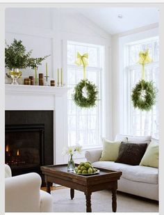Yule style!! Noel Christmas New Years Eve!! Winter Solstice!! White living room with fresh green wreaths on the windows!! With yellow ribbons!! Fresh and different for the Winter Holiday Season!