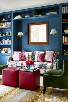Reading Nook with Stark Antelope carpet, Jasper's Malmaison fabric sofa, green chairs, and teal blue walls - design by Chloe Warner