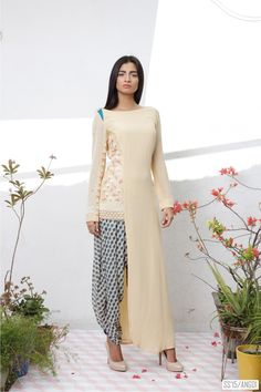 Asymmetric vanilla cream kurta, embroidered lotus motifs with beaded accents, Moroccan mosaic print green dhoti pants and peach dupatta