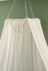 Make your own bed or ceiling canopy: Remove the inner lining from a hanging basket. Spray the basket with white spray paint, and allow to dry. Use 20-gauge wire to attach curtain panels to the top of the basket. Secure to the ceiling with appropriate hardware for your ceiling type.