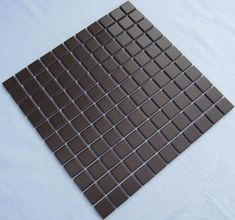 Collection: Porcelain Mosaic Tiles; Material: Porcelain; Shape: Square; Color: Chocolate; Size: 300x 300 x 5mm; Chip Size: 25x25mmMosaic Tiles specializes in quality handcrafted porcelain mosaic tiles that add excitement to your pool, home, and outdoor area. They are composed of colored porcelain tiles of different shapes and sizes arranged to form lifelike images.Each sheet of the porcelain mosaic tile is approximately 1 sq ft per sheet and is mesh mounted for easy installation of your… Mosaic Tile Designs, Ceramic Mosaic Tile, Porcelain Tiles, Kitchen Flooring, Kitchen Backsplash, Tiles Texture, Decorating Your Home, Swimming Pools, Pool Tiles