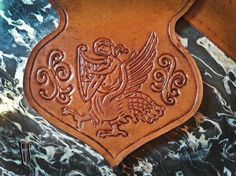 Tooled bag with siren from a medieval illuminated manuscript. My work.